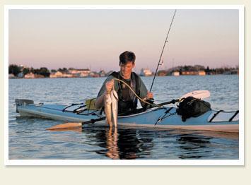 Kayaker catches fish